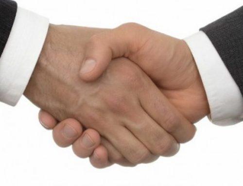 El saludo, apretón de manos